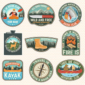 Set of Summer camp badges, patches. Vector illustration. Concept for shirt or print, stamp, patch or tee. Design with campfire, knife, hiking boots, canoe or kayak and forest silhouette