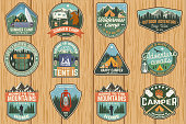 Set of Summer camp badges. Vector. Concept for shirt or logo, print, stamp, patch or tee. Vintage typography design with rv trailer, camping tent, campfire, bear, marshmallow axe and forest silhouette