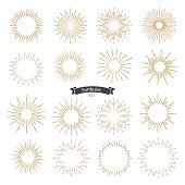 Set of sunburst design elements gold color. Vintage style elements for graphic and website design. Vector light rays elements