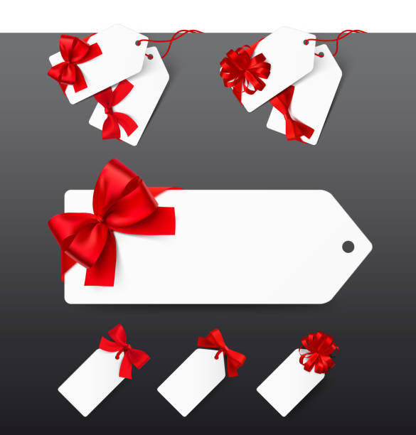 Set of tags with red bows on white background. Vector illustration. – artystyczna grafika wektorowa