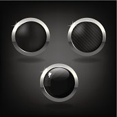 Set of three black and silver buttons on dark background.