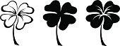 Set of three black silhouettes of four leaf clovers. Vector illustration.