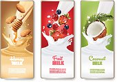 Set of three labels of of fruit in milk splashes. Strawberry, blueberry, cherry, coconut, almond, honey. Vector.