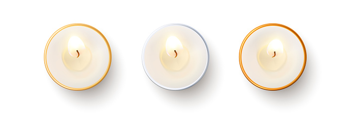Set of top view burning candles isolated on white background.