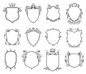 Vector set of twelve different heraldic shields with various decorative elements on a white background. Coat of arms, heraldry, emblem, symbol. Made in monochrome style. Line art. Vector illustration.