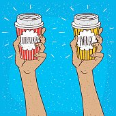 Set of two extended upwards hands holding shiny trendy paper cup of coffee, on which the inscription Cheerfulness or Energy. Blue background. Handmade cartoon style