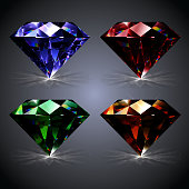 Set of isolated diamonds: blue, red, green and yellow. Gemstones shining crystals