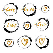 Set of vector grunge ink circles with golden hearts and