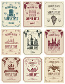 Vector set of wine labels with the image of grapes, winery, castle, sailboat, landscape, fruits and other in retro style in frames with curls