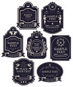Set of vintage vector labels in black and silver colors, with crowns, ribbons, angels, curls, spikelets, in figured frames