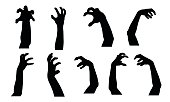 Set of vector silhouettes of scary hands suitable for Halloween, isolated on white background