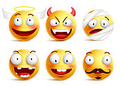 Set of vector smileys with funny faces angel and demon