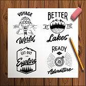 Set of vector vintage hand drawn logotype with lettering elements on wood planks