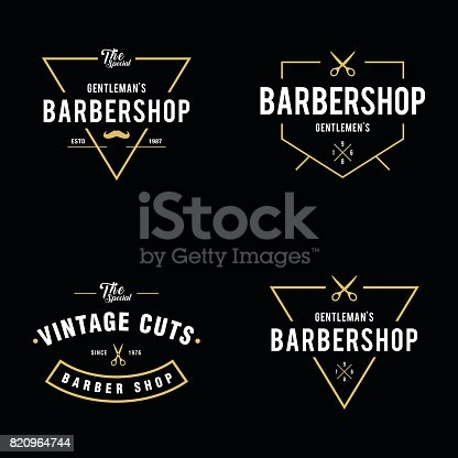 an amazing illustration Set of vintage barber shop badges and labels design elements