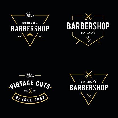 Set of vintage barber shop badges and labels design elements
