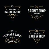 Set of vintage barber shop badges and labels design elements