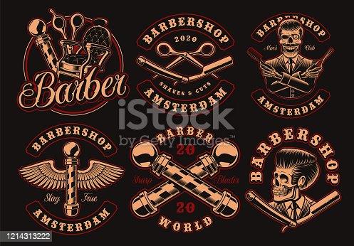 Set of vintage barbershop emblems on a dark background