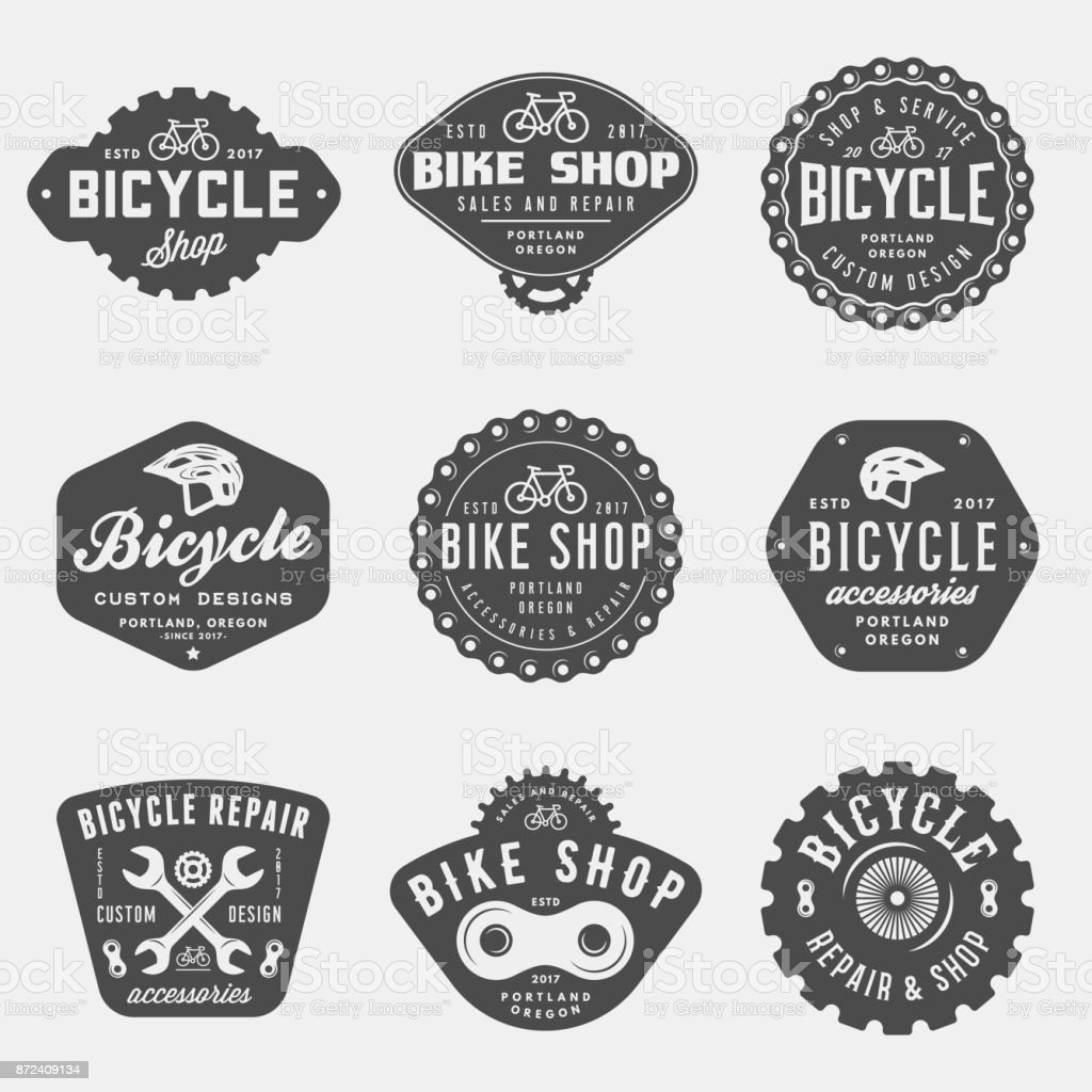 set of vintage bicycle shop and repair badges and labels