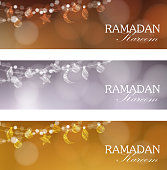 Set of web banners. Decorative strings with moon, stars, balls. Festive blurred background, bokeh lights. Card, invitation for muslim community holy month Ramadan Kareem. Stock vectors