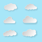 Set of white paper clouds with shadows on blue background. Vector illustration.