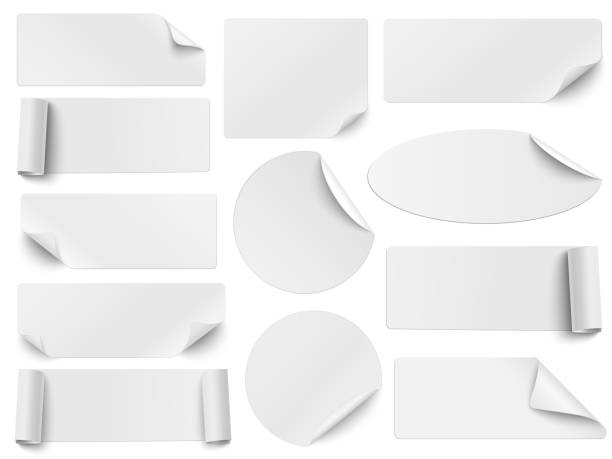 Set of white paper stickers of different shapes with curled corners isolated on white background. Round, oval, square, rectangular shapes. Vector illustration. Set of white paper stickers of different shapes with curled corners isolated on white background. Round, oval, square, rectangular shapes. Vector illustration. label stock illustrations