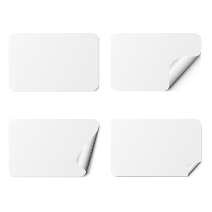 Set of white rectangle adhesive stickers with a folded edges, isolated on white background.