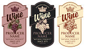 Set of three vector wine labels with hand-drawn bunches of grapes, crowns and calligraphic inscriptions in retro style in figured frames
