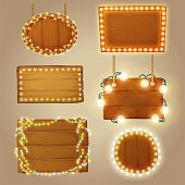 Set of wooden banners with decorative light garlands. Cartoon vector illustration