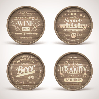 Set of wooden casks with alcohol drinks emblems
