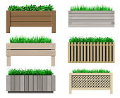Vector graphics. A set of wooden pots for plants. Grass and flowers