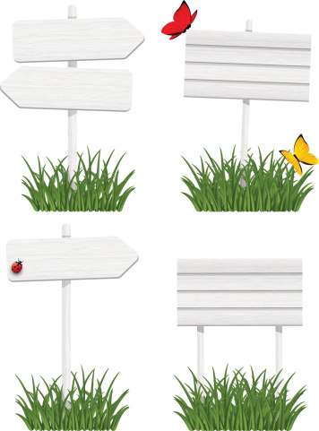Set of wooden signboards in green grass