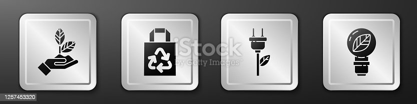 istock Set Plant in hand, Paper bag with recycle, Electric saving plug in leaf and Light bulb with leaf icon. Silver square button. Vector 1257453320