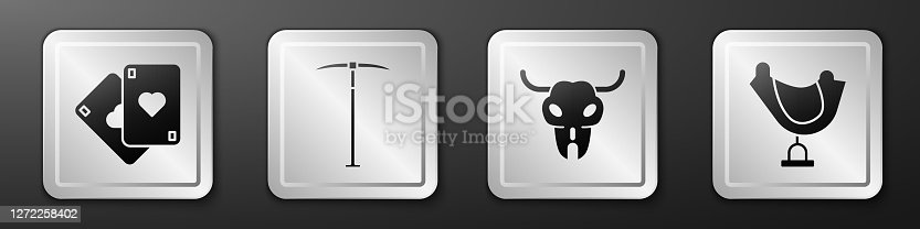 istock Set Playing cards, Pickaxe, Buffalo skull and Wild west saddle icon. Silver square button. Vector 1272258402