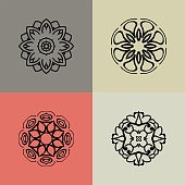 Set with four beautiful Mandalas. Vector decorative elements for your design.  Flower, oriental patterns