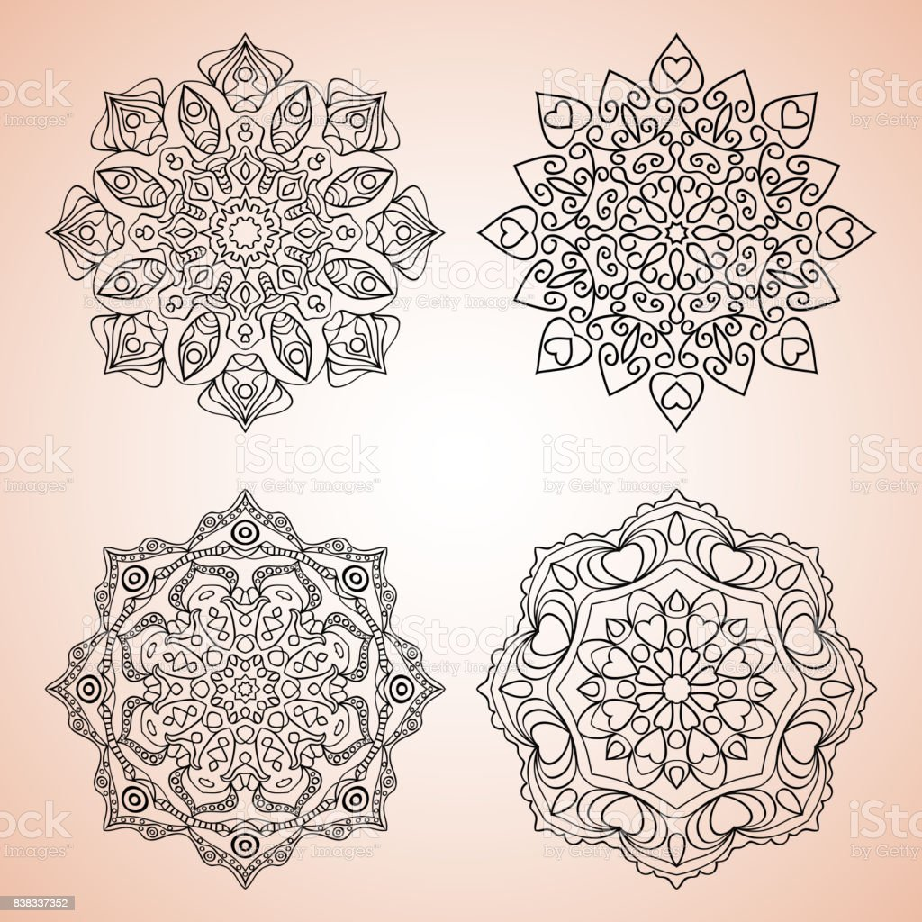 Set with four beautiful Mandalas. Vector ornaments, round decorative elements vector art illustration