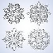 Set with four beautiful Mandalas. Vector ornaments, round decorative elements
