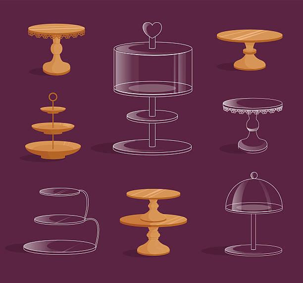 set with glass and wooden stands for cakes. - tortenständer stock-grafiken, -clipart, -cartoons und -symbole