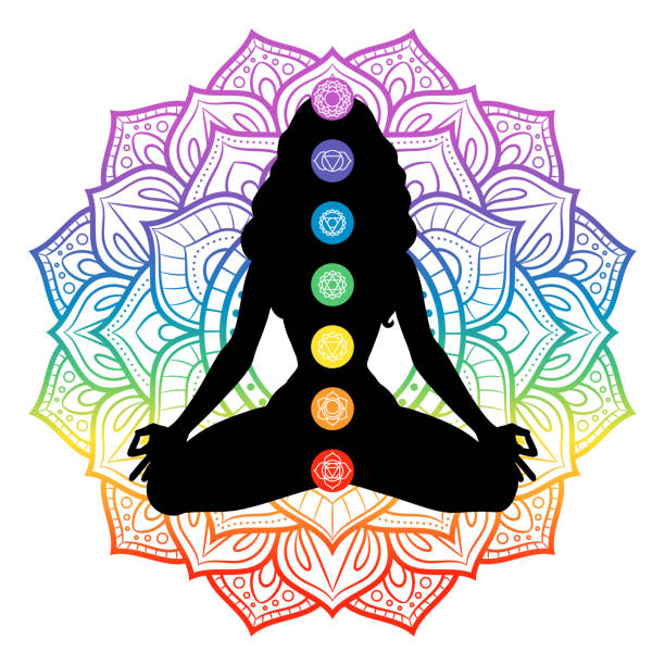 Seven chakras on meditating yogi woman silhouette, vector illustration Seven chakras on meditating yogi woman silhouette, vector illustration yogi stock illustrations