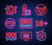 Sex shop set of icons, signs, symbols in neon style. Collection of emblems. Shop for adults, intimate things. Vector illustration. Bright night banner, luminous sign, night sex advertising shop