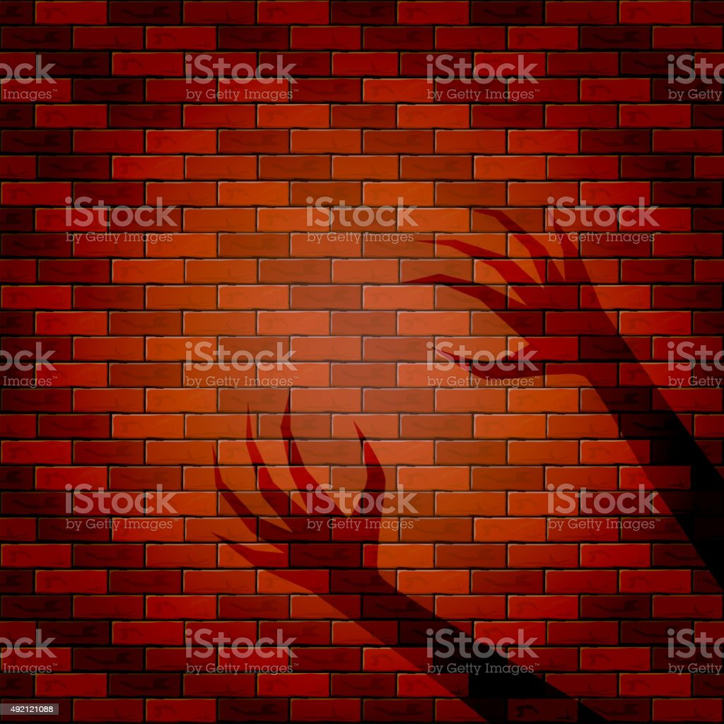 Shadow of two hand on a brick wall vector art illustration