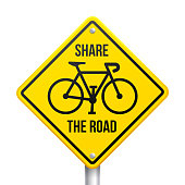 istock Share the Road Bicycling Biking Road Sign 1313349691