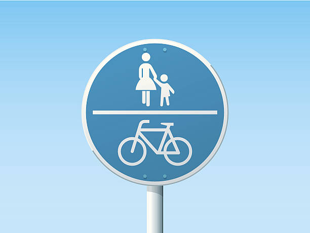 Shared Path German Road Sign Blue Vector Illustration of a german Road Sign in front of a clear blue sky: Shared Path, Pedestrian and Bicycle Lane. All objects are on separate layers. The colors in the .eps-file are ready for print (CMYK). Transparencies used. Included files: EPS (v10) and Hi-Res JPG. transportation stock illustrations