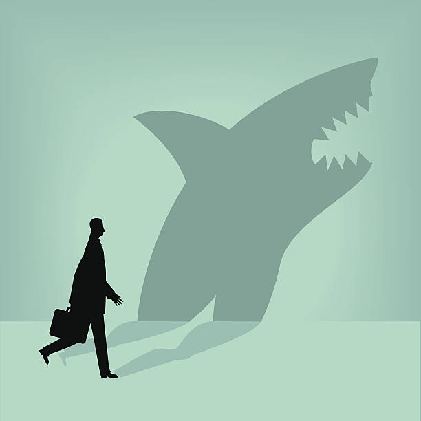 Shark Businessman is a shark in disguise. dishonesty stock illustrations