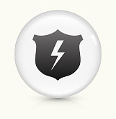 Shield and Lightning Icon on simple white round button. This 100% royalty free vector button is circular in shape and the icon is the primary subject of the composition. There is a slight reflection visible at the bottom.