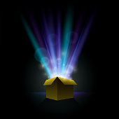 Vector illustration of a gift, with lights beaming out. Download includes: