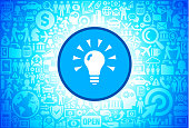 Shining Light Bulb Icon on Business and Finance Vector Background. The blue button with the white icon on it is in the center of the illustration. The button is surrounded with business and finance icon pattern. The icons vary in size and shades of blue color. There is a white glow around the round button which helps it stand out from the background. The icons include such popular business and finance symbols as business people, business meetings and travel, profits and financial charts and many more. You can also use each icon separately from the main background.