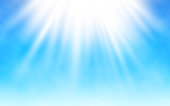 Shining sun on blue sky. White clouds and bright sun rays. Warm summer day. Realistic vector illustration.