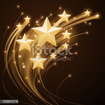 istock Shiny gold stars with trail effect 1225572713