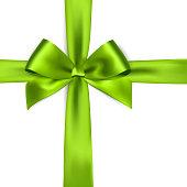 Shiny green satin ribbon on white background. Vector green bow. Green bow and green ribbon