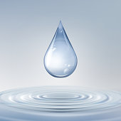 Vector clean shiny blue drop with circles on water close up front view